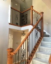 Black and Brown Railings on White Stairs